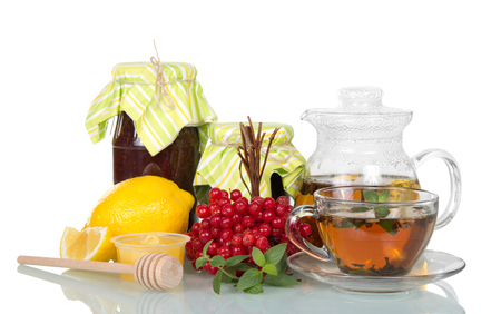 Banks with jam, hot tea with lemon for cold, bunch of berries of viburnum, isolated on white background