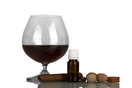 Glass with alcohol and cigar, liquid for smoking with aroma of spices, isolated on white background