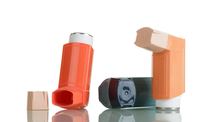 Two small portable inhaler with dispenser, isolated on white background