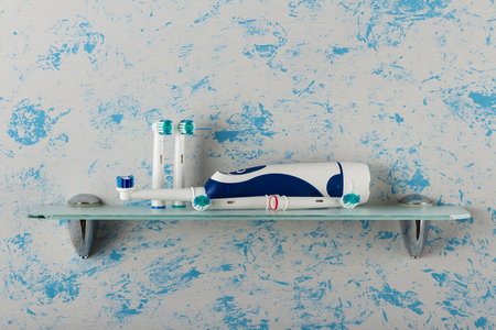 Electric toothbrush, replaceable nozzles, on glass shelf Stock Photo