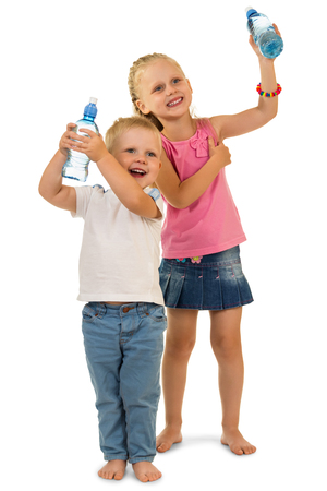 Fun playful kids holding bottle with water isolated on white