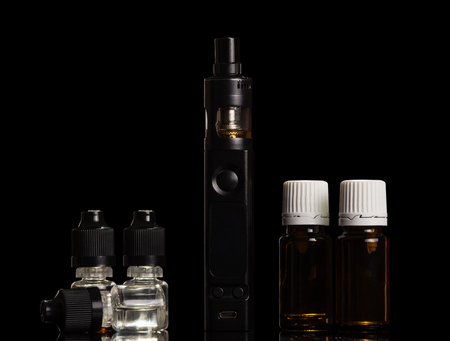 Set of aromatic liquids for inhaling steam and electronic cigarette isolated on black background Imagens