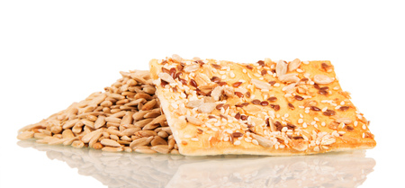 Whole grain cracker and sunflower seeds isolated on white