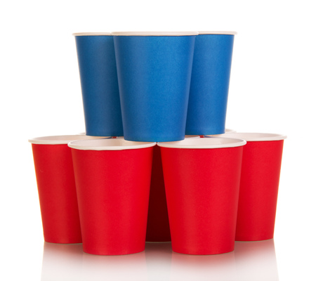 Blue and red disposable plastic cups isolated on white