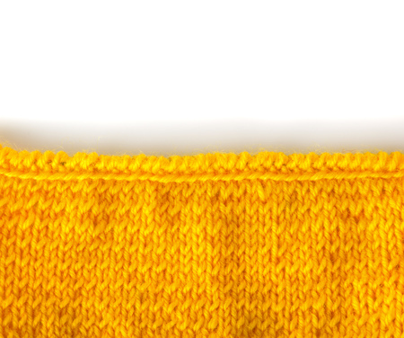 Canvas hosiery knit, close-up, isolated on white. Manual work