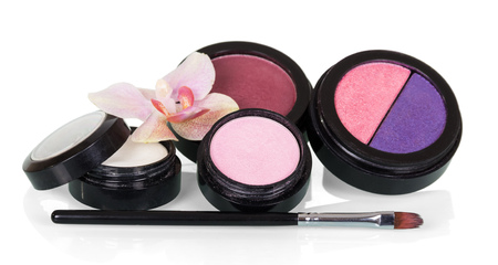 Multi-color cosmetic pressed means for makeup, and brush isolated on white
