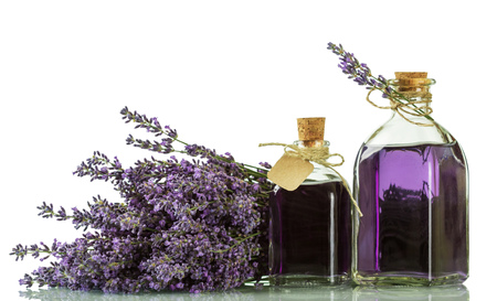 Tincture of Lavender in bottles with corks isolated on white