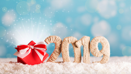 Christmas inscription 2019 and magic box magic in the snow on a blue background