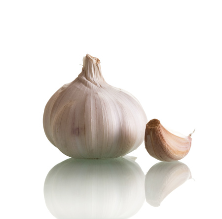 Head fresh garlic and one clove isolated on white background