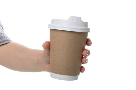 Paper eco hot cup of coffee in female hand isolated on white background 版權商用圖片