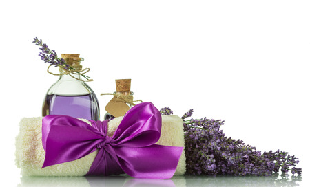 SPA concept. Lavender oil, a soft towel and fresh fragrant branches of lavender isolated on white background