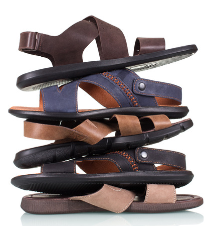 Stack of mens summer sandals isolated on white background