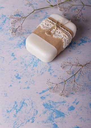 White floral handmade soap from natural raw materials on a light blue background