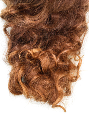 Beautiful well-groomed curly brown hair isolated on white background