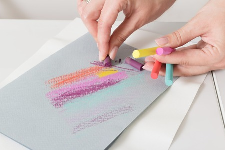 Artists hand draw chalk pastels on gray paper abstract lines 版權商用圖片