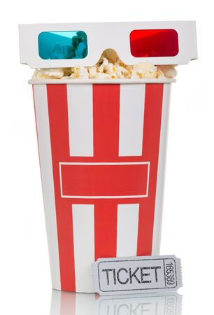3D glasses and a box filled with popcorn, gray movie ticket isolated on white background.