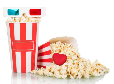 3D glasses, boxes of popcorn and spilled red heart isolated on white background.