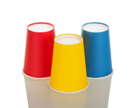 Inverted red, yellow and blue disposable tumbler isolated on white background