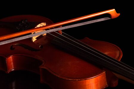 Violin and bow isolated on black background Reklamní fotografie