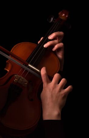 Hands of musician playing the violin isolated on black background Reklamní fotografie