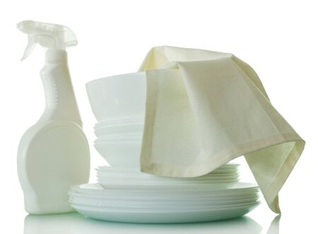 A stack of clean washed dishes, bottle of detergent and napkin isolated on white background Stockfoto