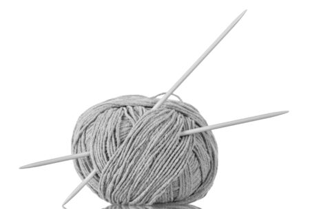 Thick grey yarn and knitting needles for hand knitting isolated on white background Фото со стока
