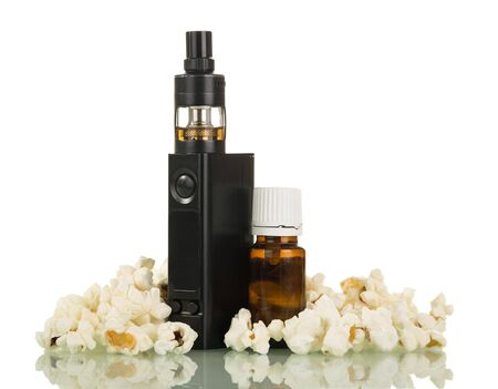 Electronic cigarette and liquid for smoking among popcorn isolated on white background