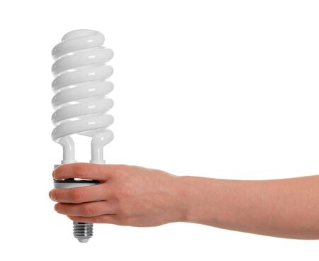 In a female hand fluorescent light bulb close-up isolated on white background.