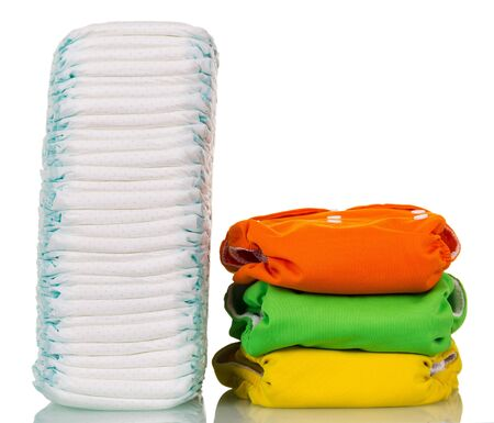 A large stack of disposable diapers reusable corresponds to several isolated on white background 写真素材