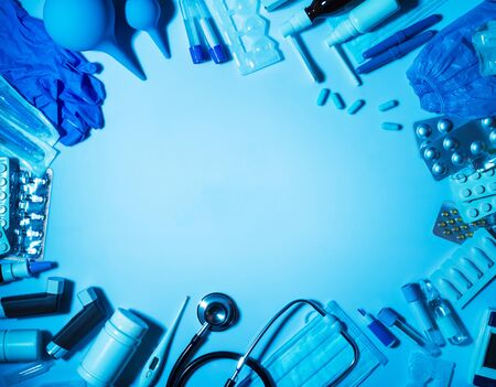 Set of medicines and first aid devices at home, on blue background