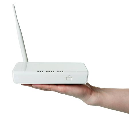 Wi-Fi router with WPS technology on female hand, isolated on white background