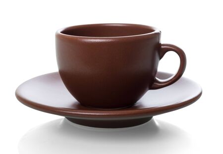 Cup and saucer for aromatic morning coffee, isolated on white background