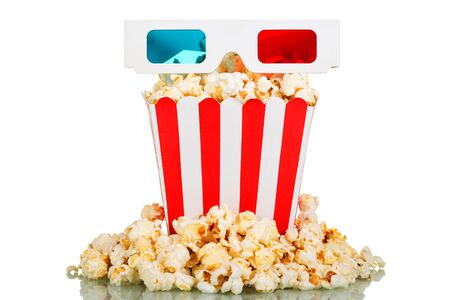 3D glasses, a large square box of popcorn, popcorn around isolated on white background.