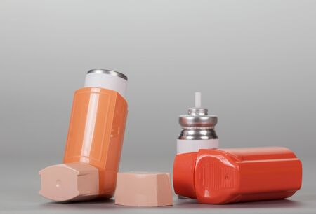 Device for inhalation with a dispenser on gray background