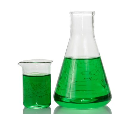 A chemical flask, a beaker with green liquids and a sheet of paper with formulas isolated on a white background.