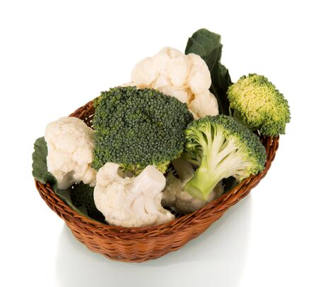 Ripe inflorescences of broccoli and cauliflower in a basket isolated on white background.