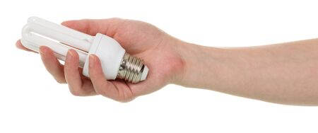 In a female hand a compact fluorescent light bulb is isolated on a white background.