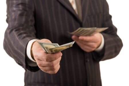 Money banknotes in hands of a man, isolated on white background Imagens
