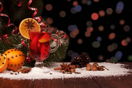 Spicy warming drink, fruits, nuts and spices on shimmering dark background 版權商用圖片
