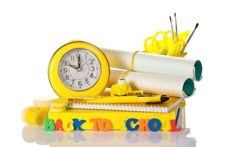 Set of school supplies, an alarm clock and an inscription back to school, isolated on white background