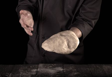 Process of kneading dough by hand,isolated on black background
