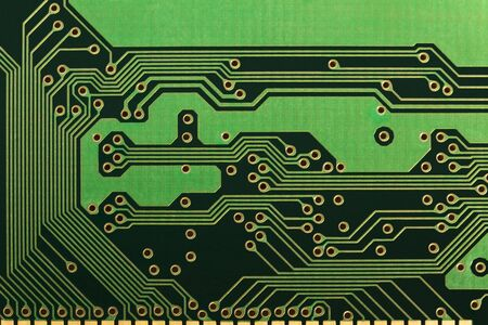 Printed circuit Board with holes for mounting, shown in close-up. Background