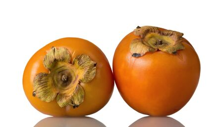 Sweet, vitaminized persimmon fruit isolated on white background 写真素材