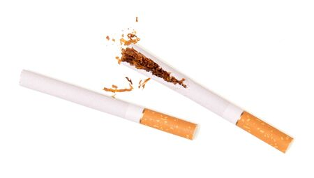 Two cigarettes, one broken, isolated on white background