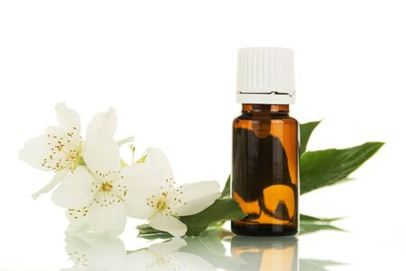 Bottle of aromatic liquid for vaping electronic cigarette and Jasmine flower isolated on white background