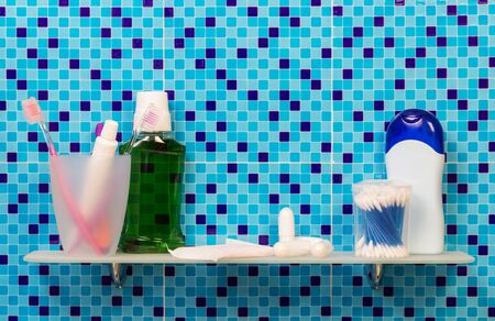 Shelf with feminine hygiene products in the bathroom on the abstract blue background. Stok Fotoğraf