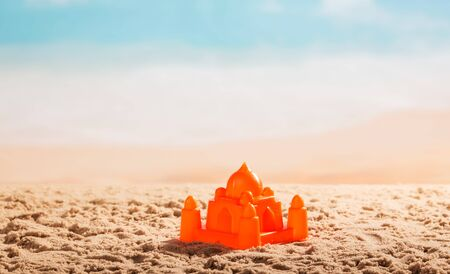 Plastic Castle in the sand on the against the sea.