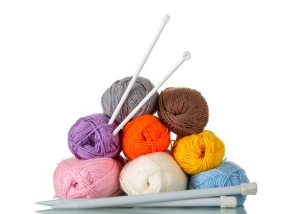 Multi-colored skeins of wool yarn for knitting. Close-up isolated on a white background.