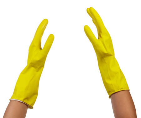 Female hands in rubber tight yellow gloves for cleaning isolated on white background