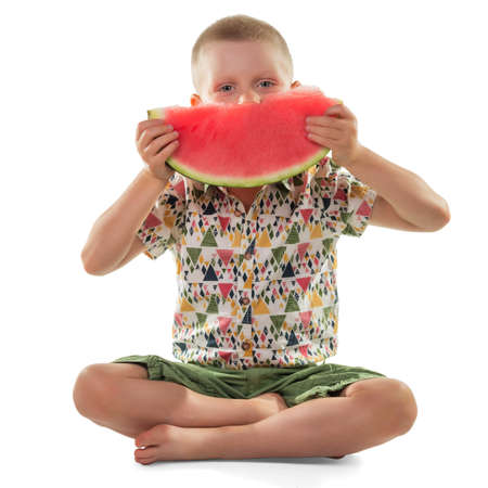 Happy little boy with a large slice of ripe watermelon isolated on white background